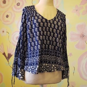 Peasant blouse, featuring floral print and ruffles